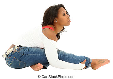 Beautiful athletic black woman stretching before hip hop...