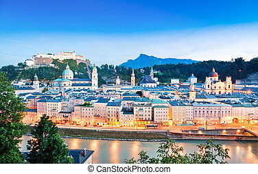 Panoramic view of Salzburg skyline with river Salzach at dusk