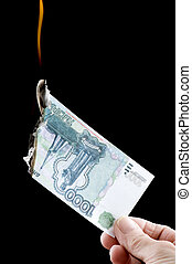 burning paper currency - object on black - currency burning...