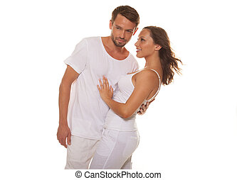 Happy couple embracing wearing white