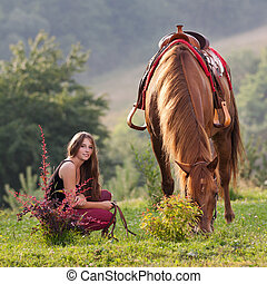 Young girl with a horse - Young girl with long hair is...