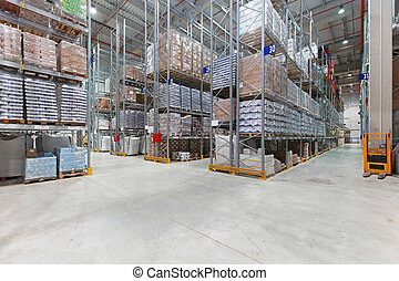 Distribution warehouse - Shelves with goods in distribution...
