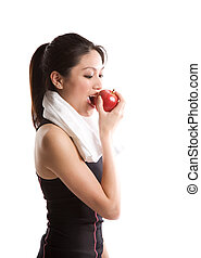 Asian girl exercise and eating apple - An isolated shot of...