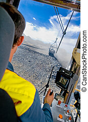 Dragline operator in coal mine - A dragline being operated...