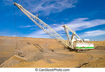Dragline in coal mine - Dragline operating in an open cut...