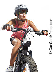 female cycling athlete riding mountain bike and equipped...