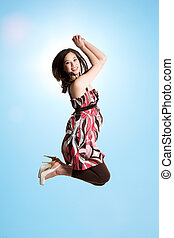 Jumping for joy - A beautiful asian woman jumping for joy