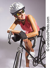 young smiling female sportswoman with old school singlespeed...