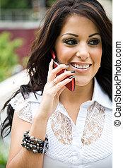 Hispanic businesswoman on the phone