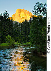 The warm glow of Half Dome's face during sunset at Yosemite...