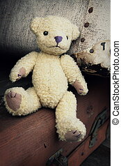 Nostalgic Teddy Bear - Teddy bear is sitting on a stack of...