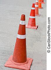 Orange cones.  - Orange cones.