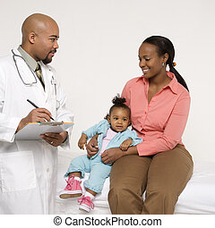 Child with pediatrician - African-American mother and baby...