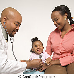 Girl getting doctor exam - African-American male...