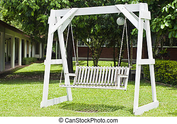 White wooden swing - White wooden swing outdoor in sunlight...