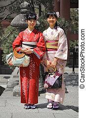Smiling Asian Women - Smiling asian women wearing kimono...