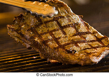 Barbecue  - Slice of beef on barbecue grill.