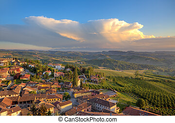 Small italian town on the hills at sunset. - View of small...