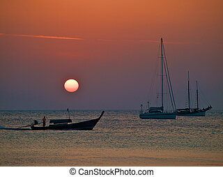 Yachts on a sunset - Tropical sunset with the anchored...