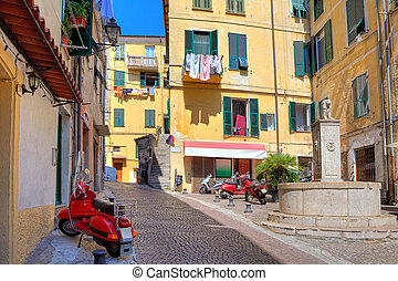 Small plaza among colorful houses in Ventimiglia, Italy. -...