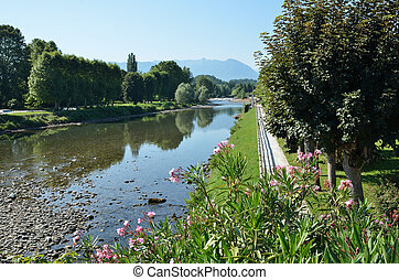 Summer view of the French town Nay - The green park is...