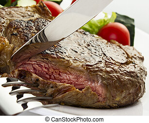 Juicy steak with fork and knife