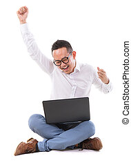 Excited Asian man using laptop - Full length of excited...