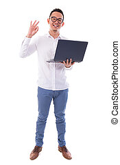 Asian man using laptop showing ok sign - Full length of...
