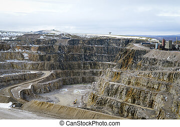 Working Stone Quarry - Snow covered stone quarry in the...