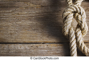 Old wood with rope knot