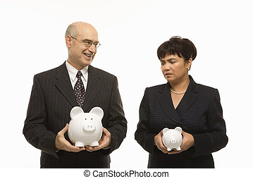 Businesspeople holding piggybanks - Caucasian middle-aged...