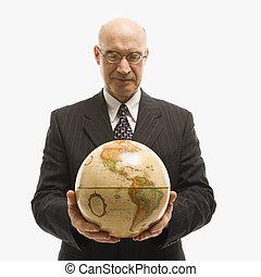 Businessman holding globe. - Caucasian middle-aged...