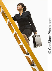 Businesswoman climbing ladder. - Filipino middle-aged...