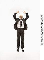 Businessman jumping. - Smiling Caucasian middle-aged...