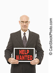 Man with help wanted sign - Caucasian middle-aged...