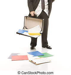 Businessman losing papers. - Caucasian middle-aged...