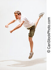 male dancer jumping in the air - sport and dancing concept -...