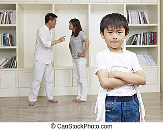 asian boy and quarreling parents - 6-year old asian boy with...