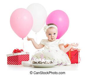 Joyful baby girl with cake, balloons and gifts. Isolated on...