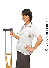 Smiling medical doctor holding crutches