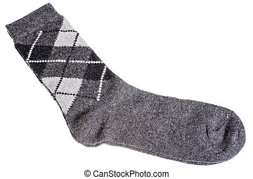 Warm woolen socks with a pattern of diamonds on a white...