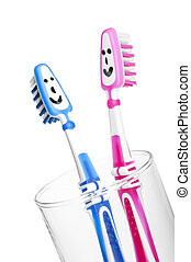 two smiling toothbrushes in a glass