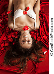 Beautiful Nude Woman in Rose Petals