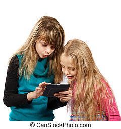 two girls playing with tablet pc