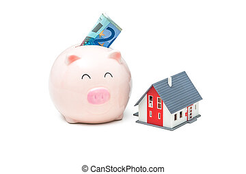 Home finances - Piggy bank and house on the white background