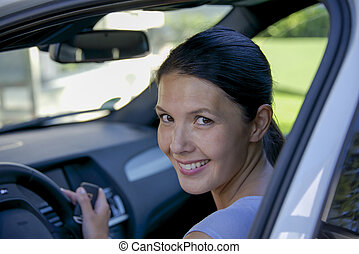 young woman sitting in her car
