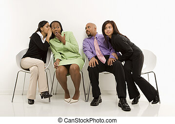 Business secrets - Multi-ethnic businesswomen whispering and...