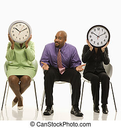 Work time concept. - Businesswomen sitting holding clocks...