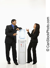 Water cooler talk. - Vietnamese businesswoman and Indian...