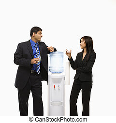 People at water cooler. - Vietnamese businesswoman and...